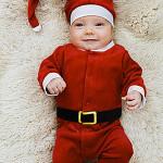 Baby Wearing Santa Claus Costume --- Image by © Bernd Vogel/Corbis